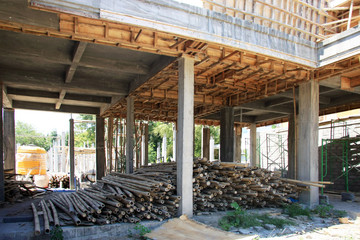 Bamboo/Timber sonstruction site in Bali, Indonesia - with piles of bamboo poles in foreground