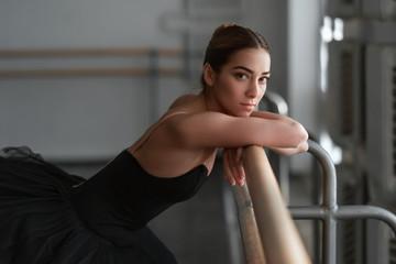 Female ballet dancer resting after rehearsal