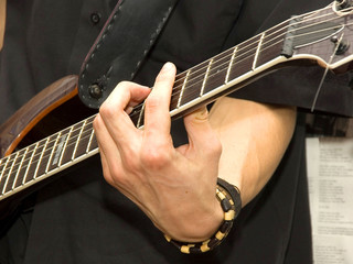 Shot of hands playing an acoustic guitar.