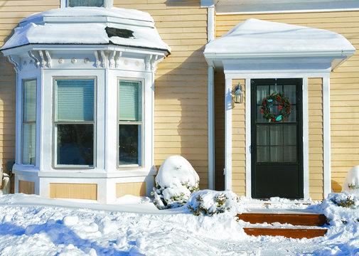 After a winter storm snow piles up in an urban neighborhood.