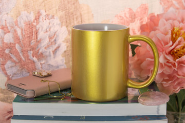 Mock-up of a golden mug with some feminine stuff