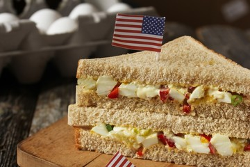 Mayo egg sandwich with american flag on top, selective focus
