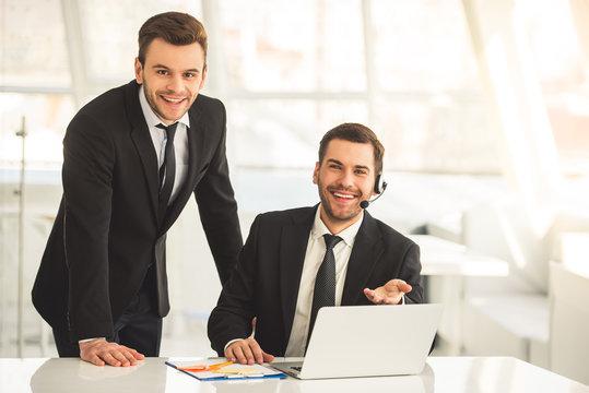 Handsome businessmen working