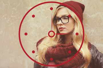 Fashion woman in glasses on wall background