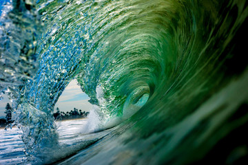 A Wave breaks on the shore