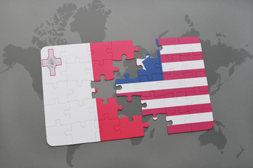 puzzle with the national flag of malta and liberia on a world map