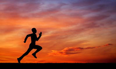 Silhouette of running man on sunset fiery sky background
