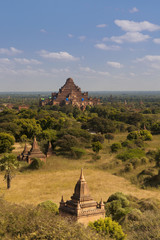 Image of ancient temples in Bagan Myanmar on a sunny day blue sky