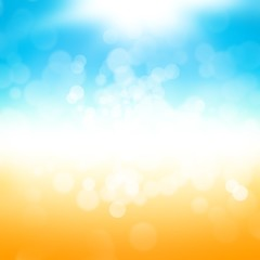 Abstract yellow and blue blurred background. Sandy beach backdrop with turquoise water and bright sun light. Summer holidays concept. Vintage style. Summer background