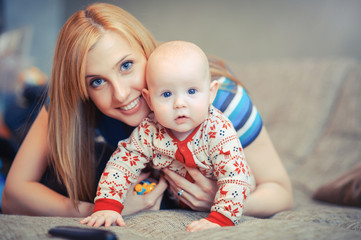beautiful blue-eyed mother with baby