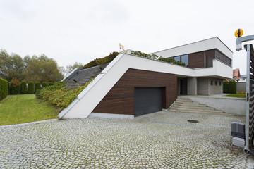 Villa exterior with garden roof
