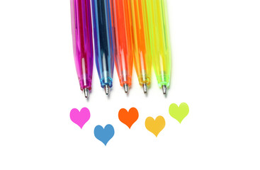 Bright colorful pens and abstract hearts