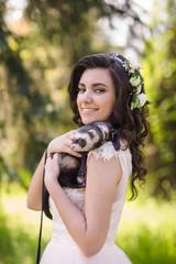 pretty bride in wreath outdoor
