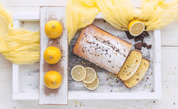 lemon cake with fruits on white wooden surface
