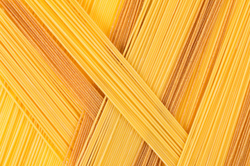 Italian long spaghetti top view abstract background of different colors. Wall mural