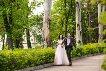 groom andg bride go for a walk