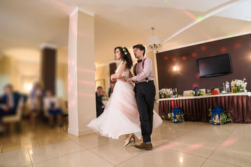 Dancing wedding couple in restaurant
