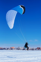 Paragliding in Ukraine over the against clear blue sky