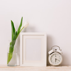Frames, clock and flower