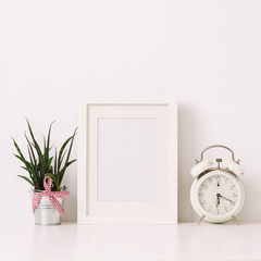Frame, clock and flower