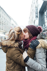 Lesbian couple kissing on the street