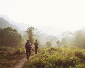 Man and Woman hiking as the sun rises