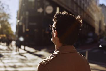 Man in trench coat in city