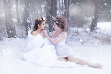 Queen of snow and Mrs. spring. Snow Queen - Winter wraps spring and puts it to sleep - sleepy. Spring asleep wrapped in the winter.