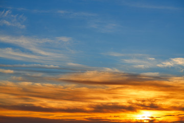 Sunset sky orange clouds over blue