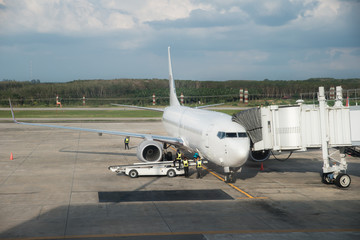 Airplane at airport terminal gate ready for takeoff. Modern international airport.