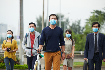 Passers-by protected themselves from swine flu with help of masks while walking in Asian city