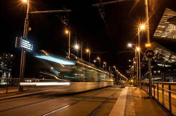 Tram at night with motion blur, urban view. Barcelona, Spain