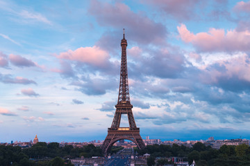 Eiffel Tower in colors of pink twilight Paris