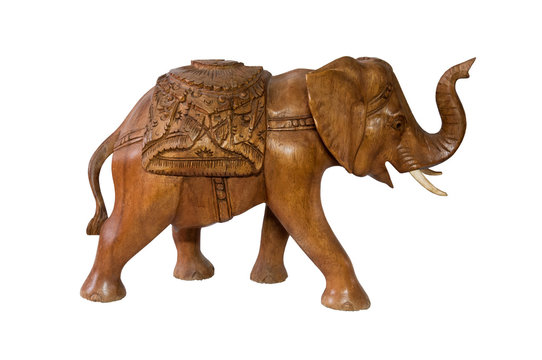 Statue of an elephant made of wood isolated on white
