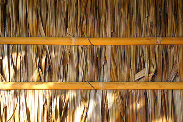 House's wall made from dried leaves of the nipa palm and bamboo. old wall textured background.