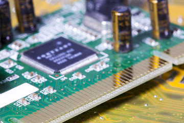 Electronic chip and standard inscriptions of resistors and condensers, small depth of sharpness....