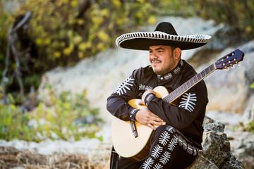 Mexican musician, a guitarist on the beach.