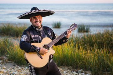 Mexican musician, a guitarist on the beach.