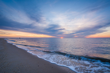 Sunset over the Delaware Bay, at Sunset Beach in Cape May, New Jersey. Wall mural