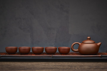 Traditional tea ceremony accessories, teapot and teacup with wooden background
