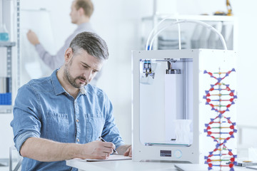 Scientist with 3D printer