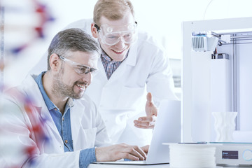 Chemists with laptop and printer