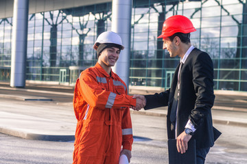 young boss and worker shaking hands.Agreement. Business modern background