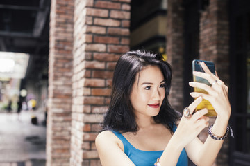 Young asian businesswoman using smartphone