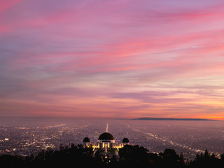 Illuminated city at sunset, Los Angeles, California, United States of America