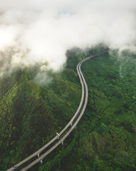 Green hills and winding highway, Ohau, Hawaii, United States of America