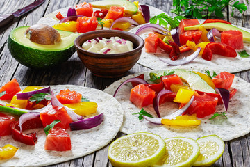 fajitas with chunks of smoked salmon, close-up