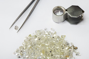 Diamonds, tweezers and loupe