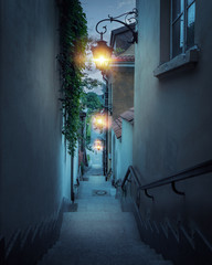 Romantic street of the old town in Warsaw at night, Poland