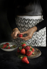 Woman slicing strawberries